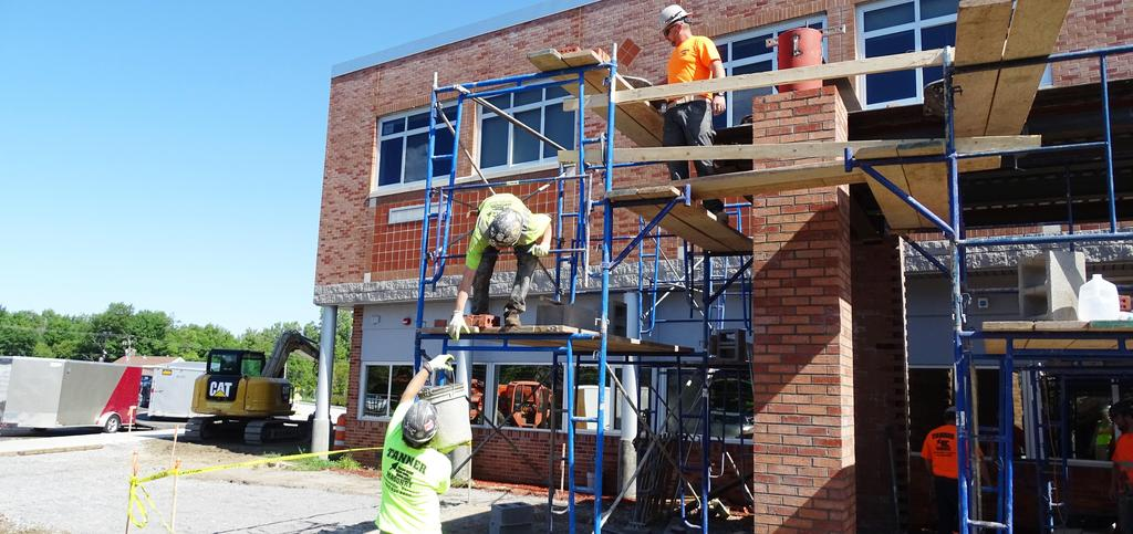 Pictured are masonry crew members engaged with exterior brick construction and concrete block construction at Beekmantown Elementary School's expanded main pedestrian entrance, August 2019.
