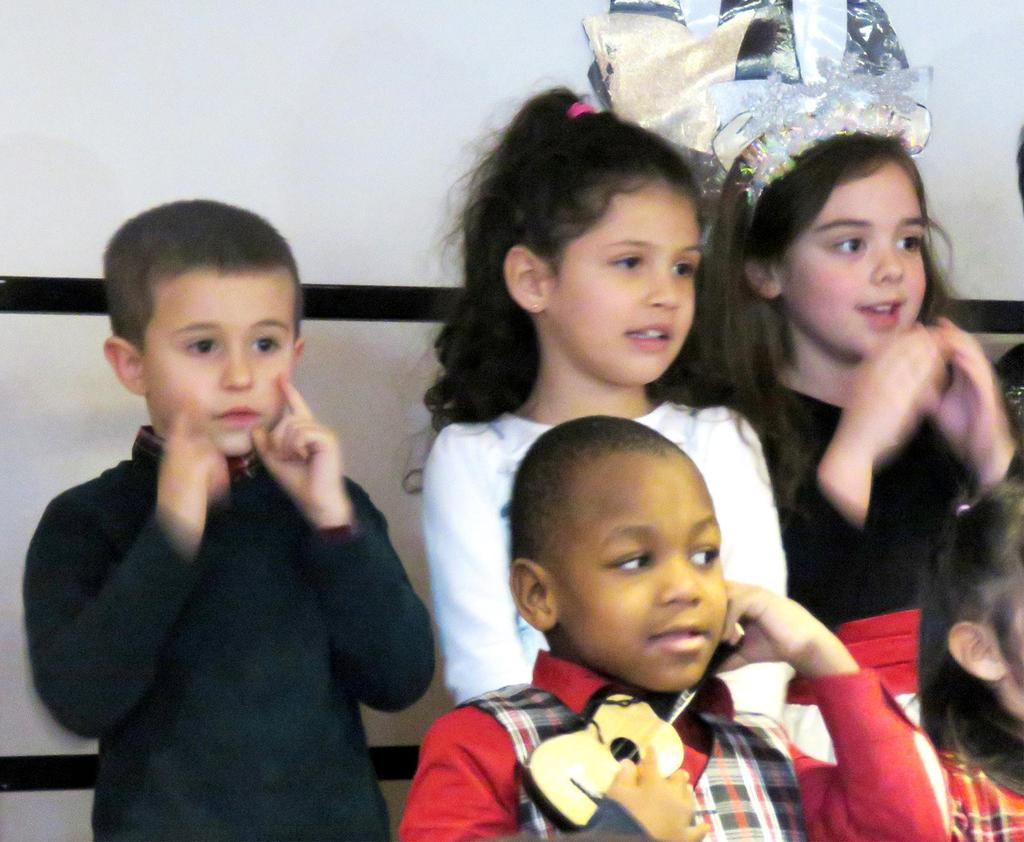 A close-up of four students singing