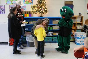 Picture of Ms. Shauna Wilson hugging Braylin Smith who nominated her for the WIVK Teacher of the Month.