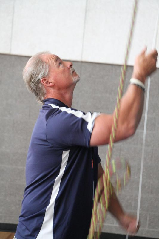 Rick Zimmer setting climbing ropes in a gym