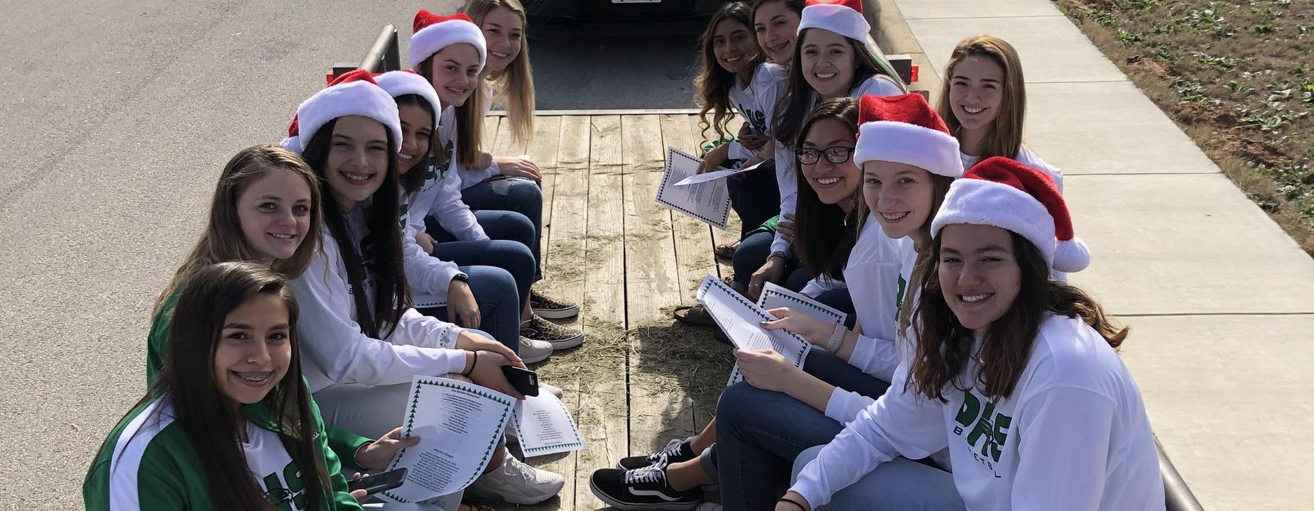 Varsity BB girls caroling