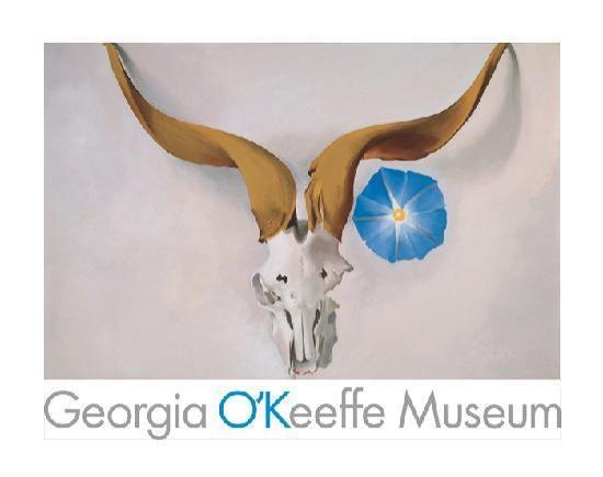 """Georgia O'Keeffe's painting """"Ram's Head, Blue Morning Glory"""" with the museum's title underneath"""