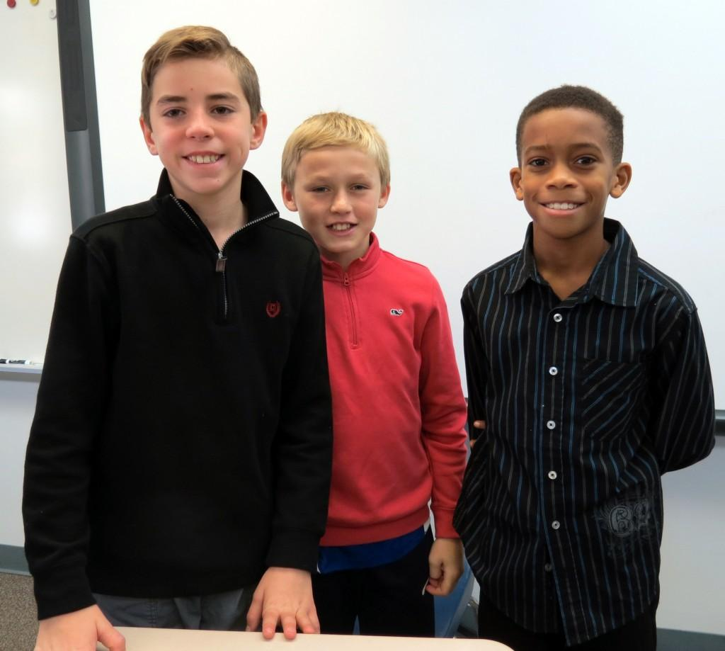 Three students in classroom on Leadership day
