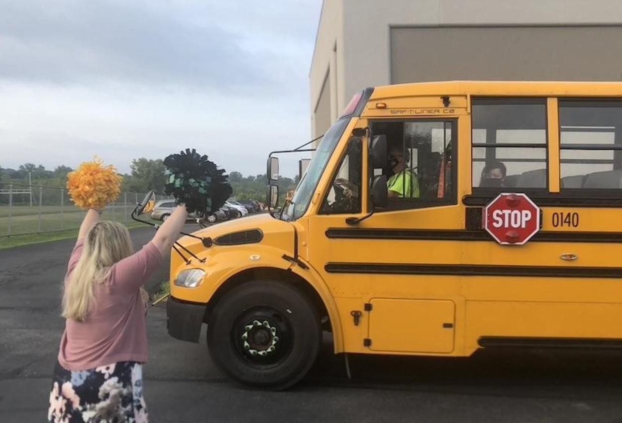 teacher greeting bus