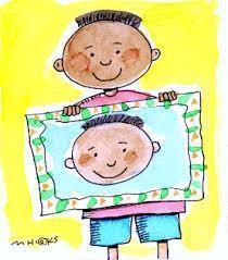 boy holding self portrait
