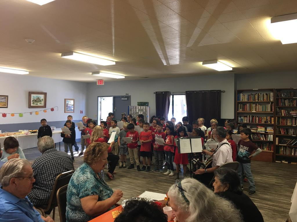 Second graders singing at the senior center