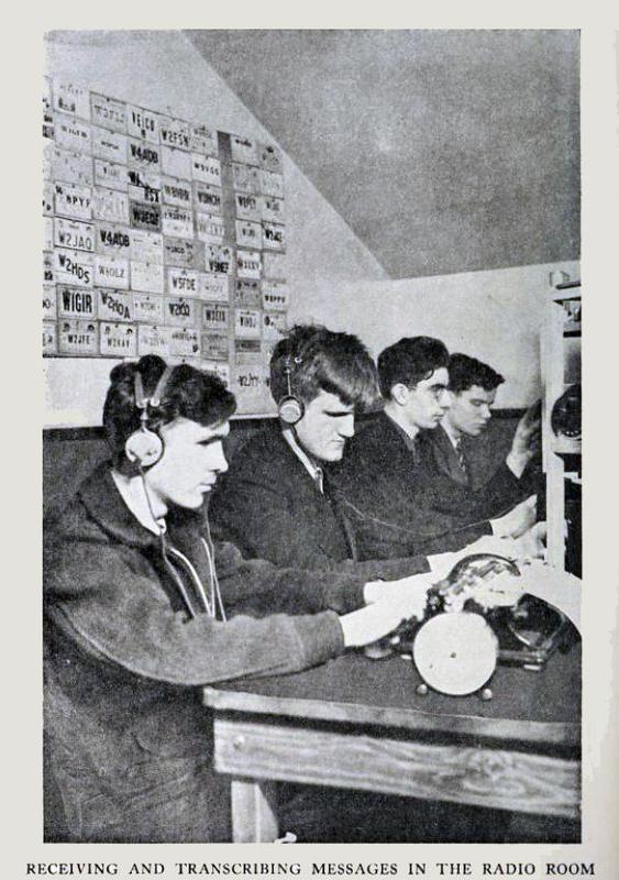 Pictured here with 2 other students using their hams, TEXT: Students recieving and transcribing messages in the Radio Room