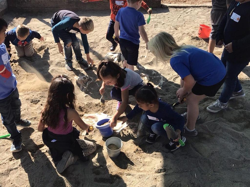 children digging in dirt