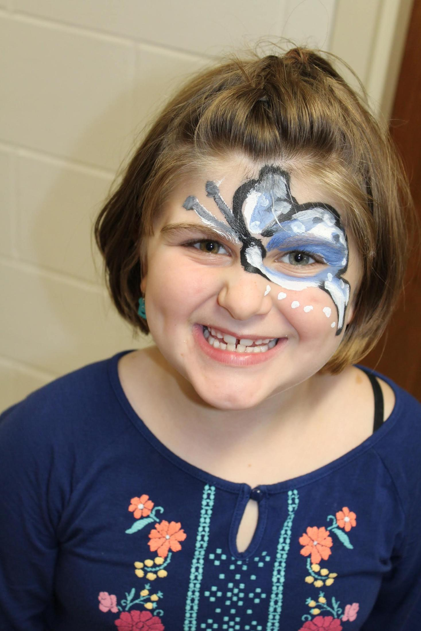 Student with a butterfly on her face.