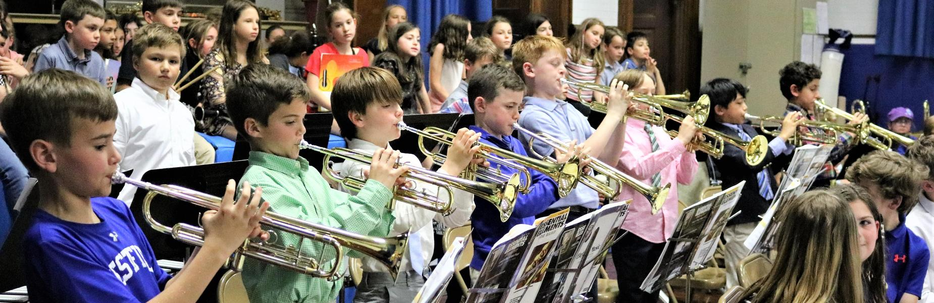Photo of 4th grade trumpeteers performing in Wilson School Spring Band Concert.