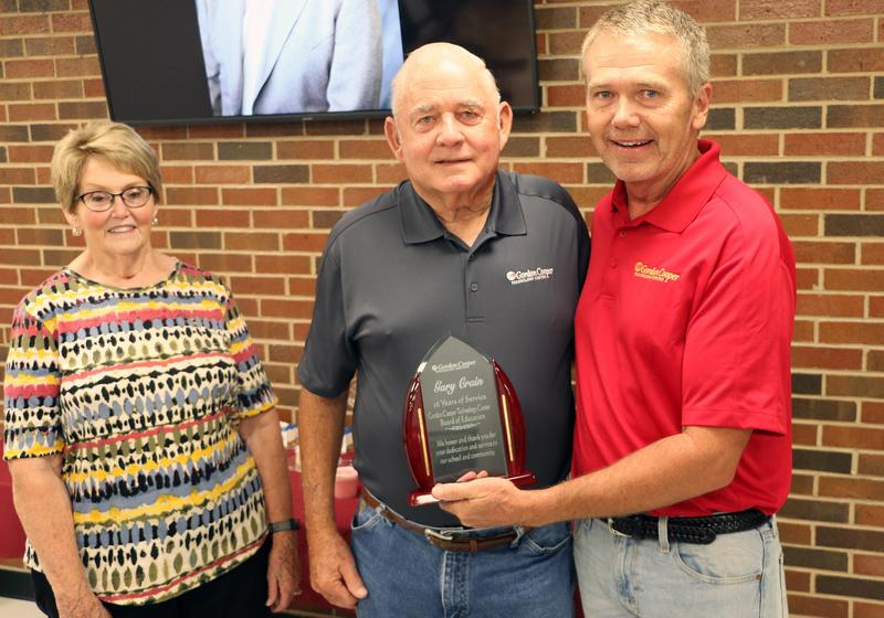 Gary Crain (center) pictured with current board vice president Jimmy Gibson.