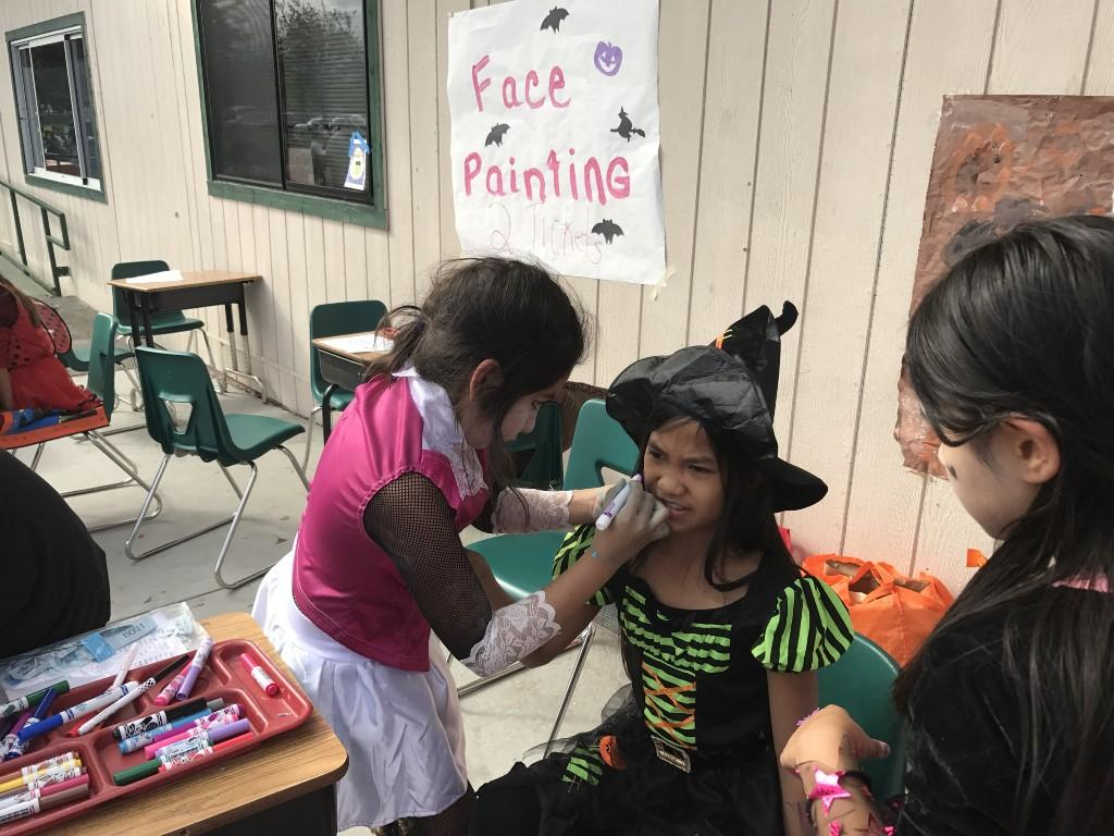 Student painting another's face