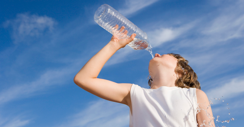 Student drinking water on a hot day.