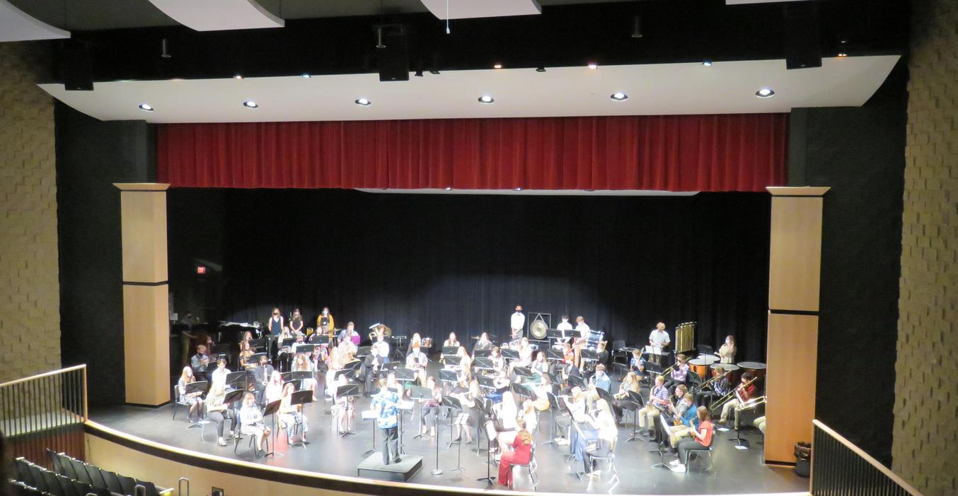 The TKHS Concert Band performs in the auditorium.