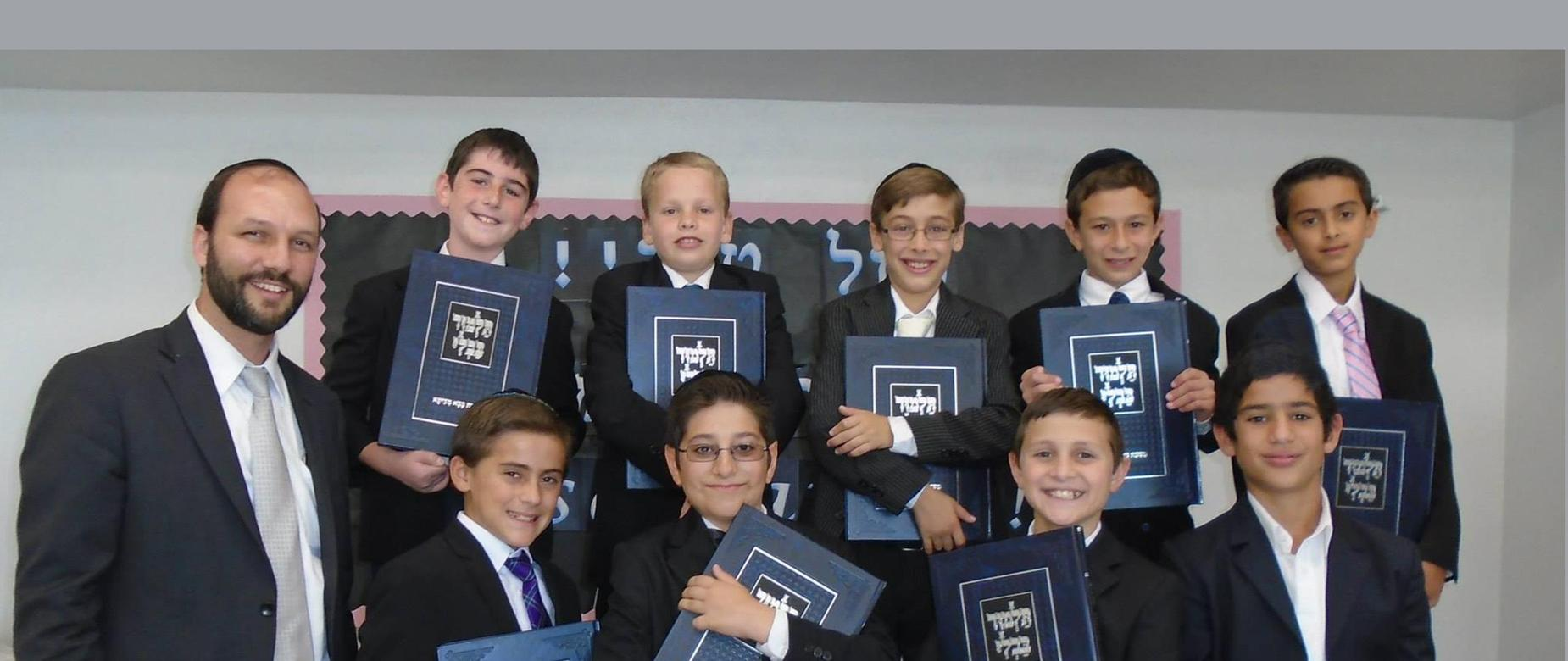 Rabbi Ungar with boys and their new Gemaras