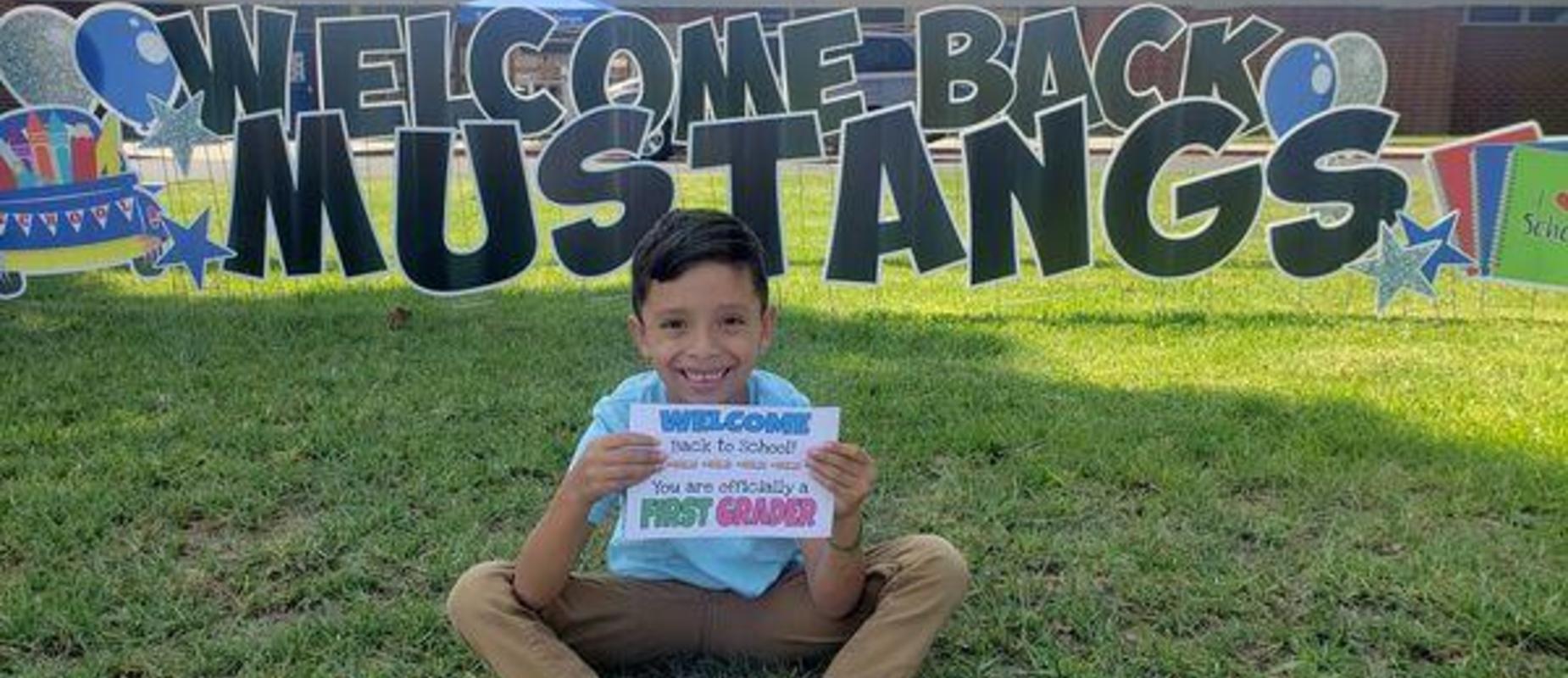 Boy with school sign