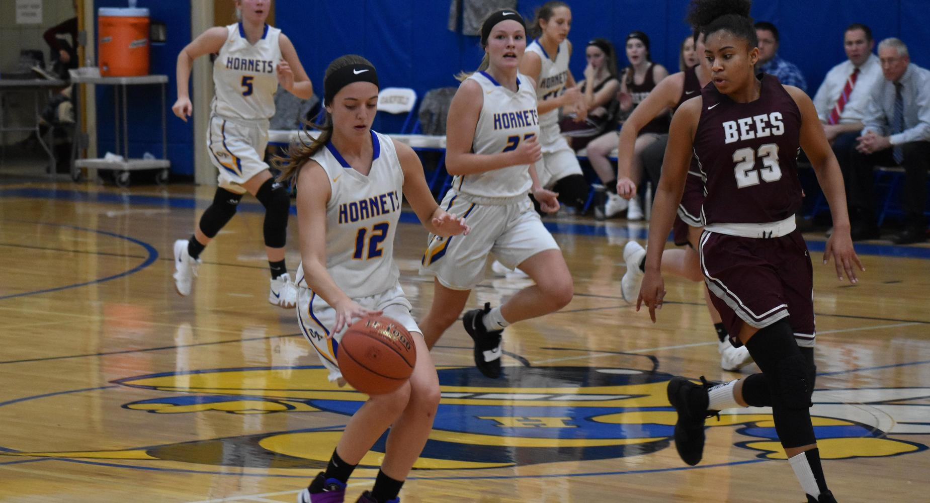 girls basketball players running on court