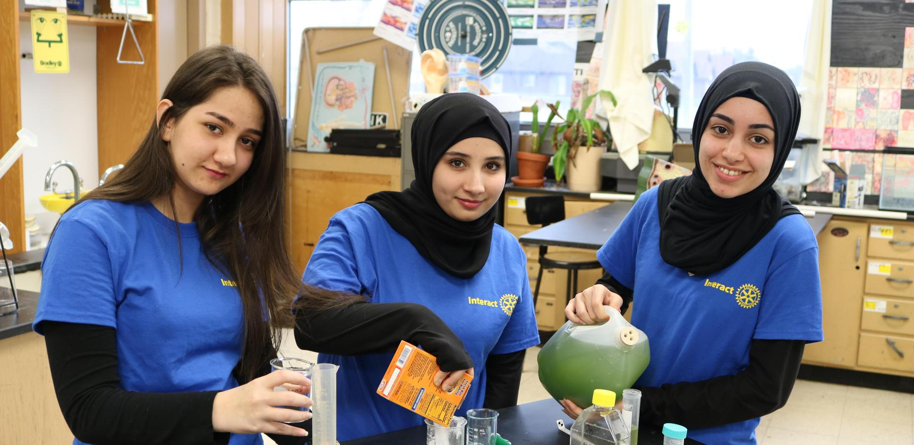 Three Female Students in the Chemistry Lab