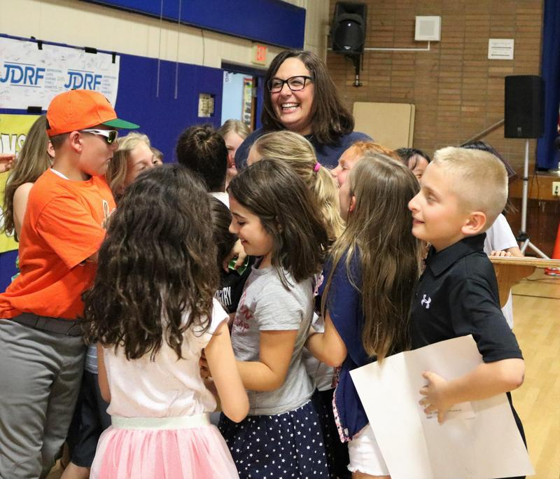 Photo of Jefferson 4th graders surround their teacher, Anna Carissimo, as she is honored at May 7 Board of Education meeting as the recipient of the 2019 Charles Philhower Fellowship Award which recognizes outstanding elementary school teachers