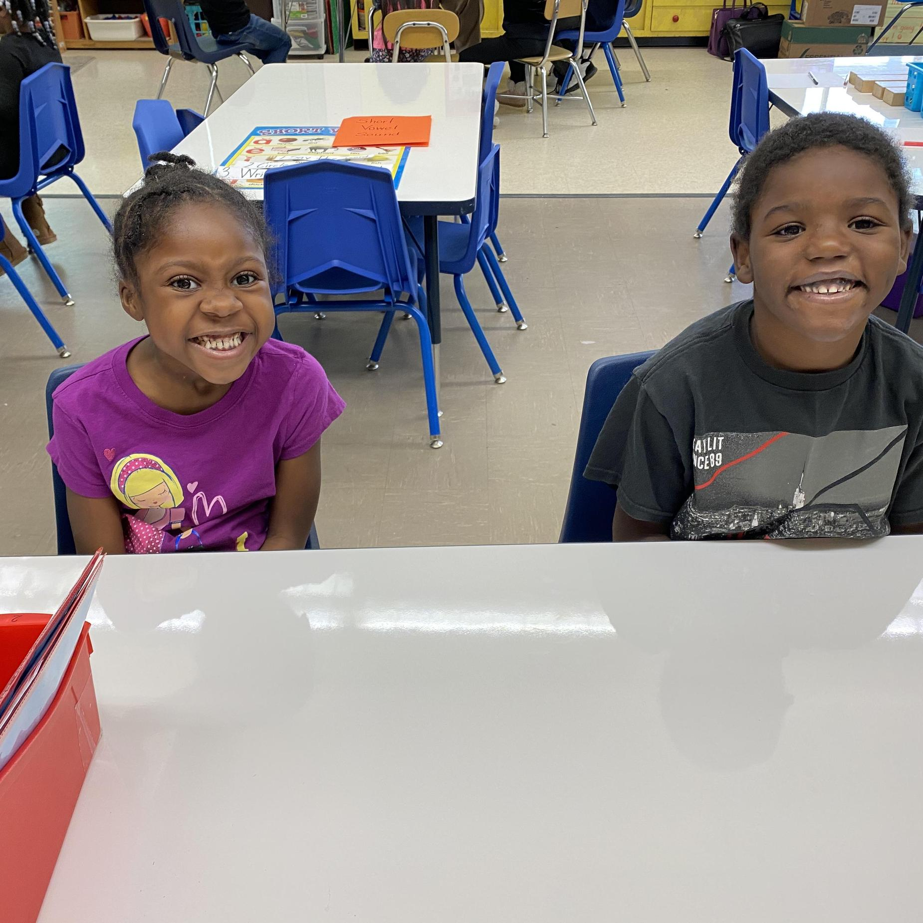 Two students smiling.