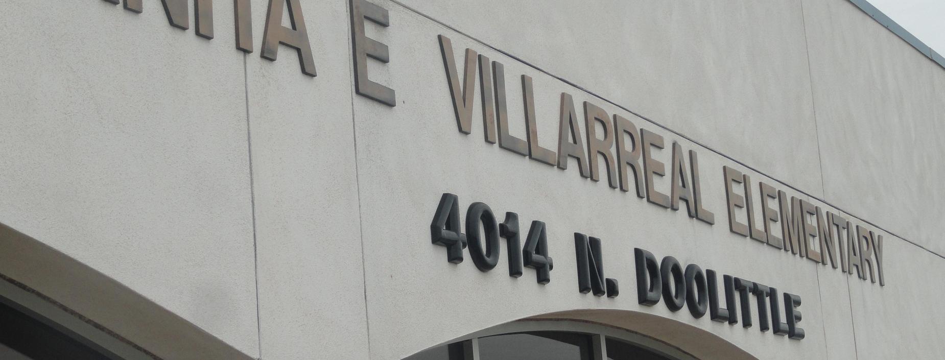 school name on front of school building