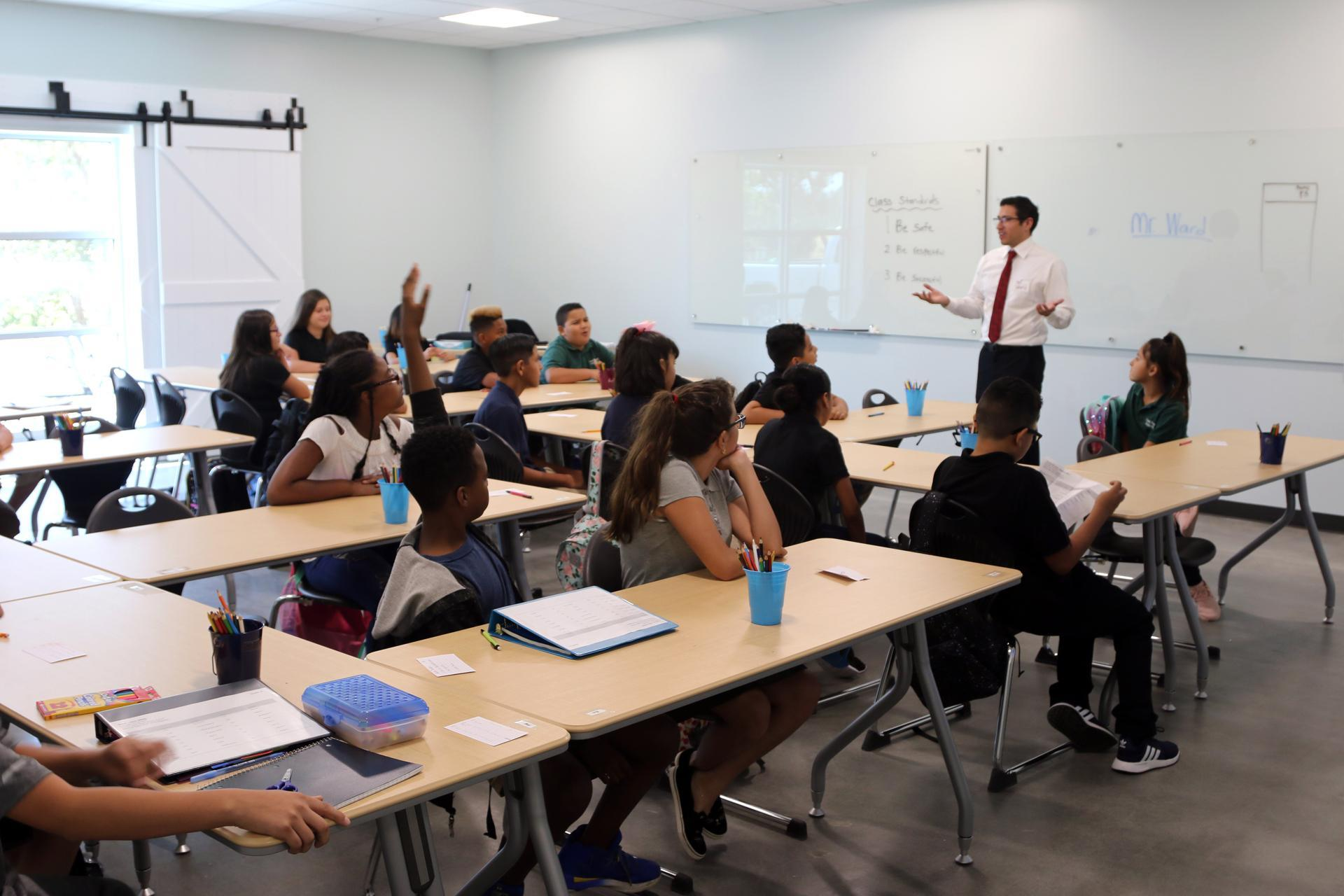 Classroom discussion with teacher and students