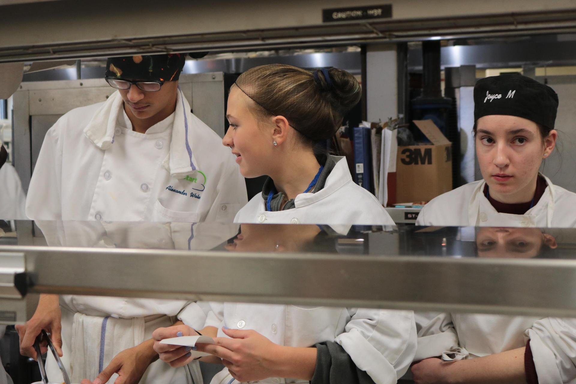 Students working on the line in kitchen