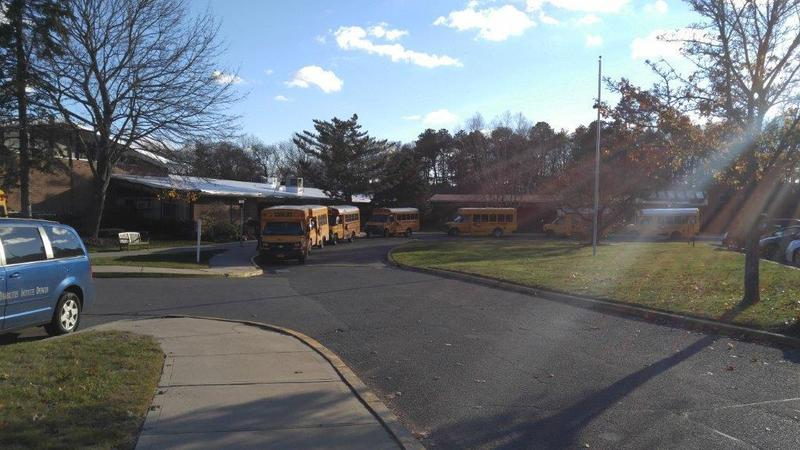 Picture of school building with buses in front
