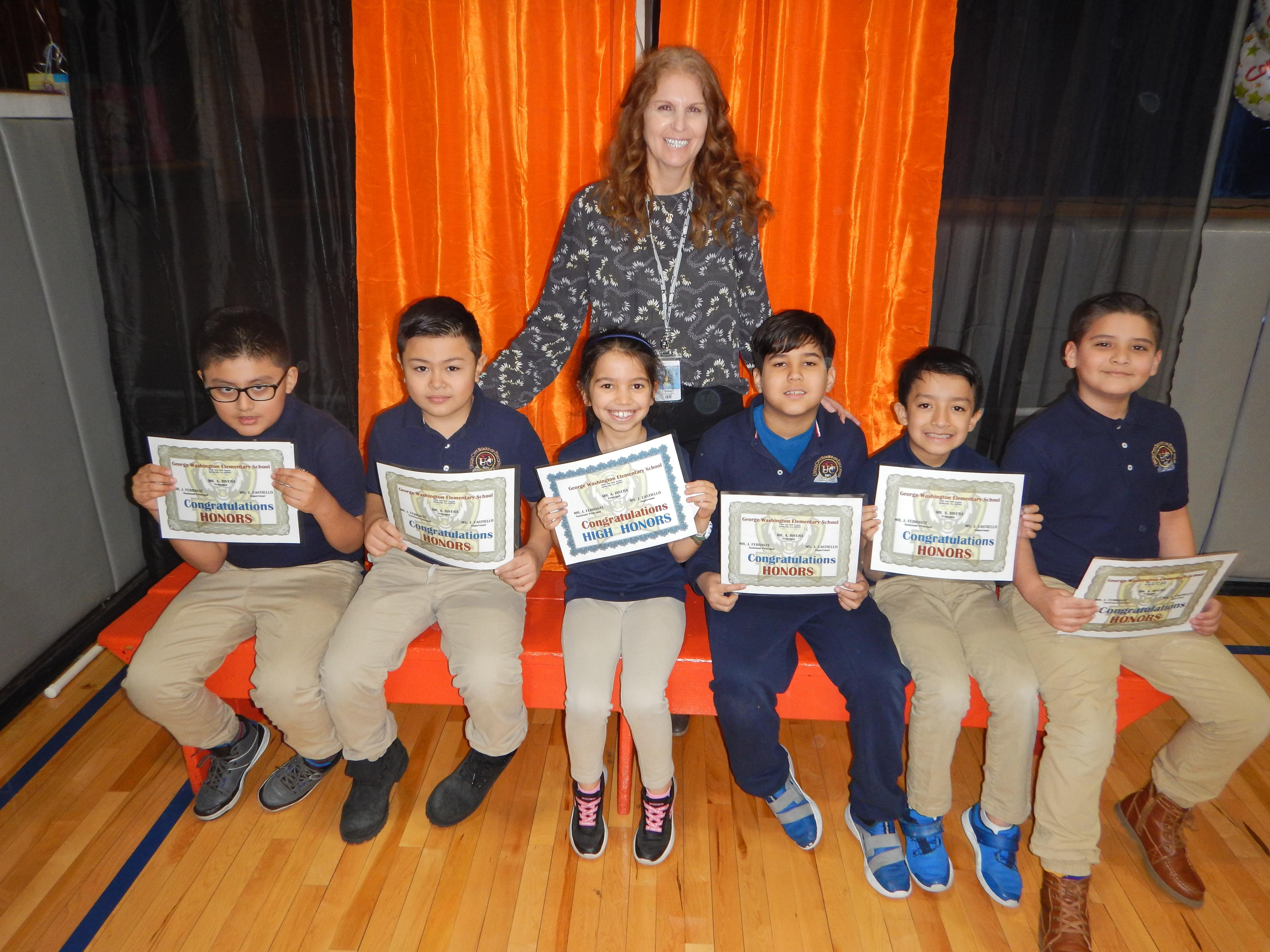 6 Honor Roll Students with their Teacher and certificates
