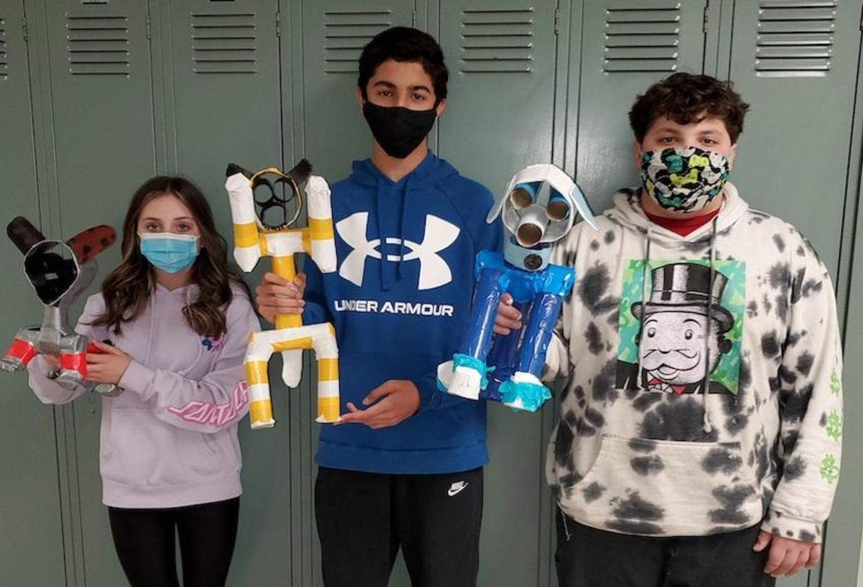 students with animal sculptures