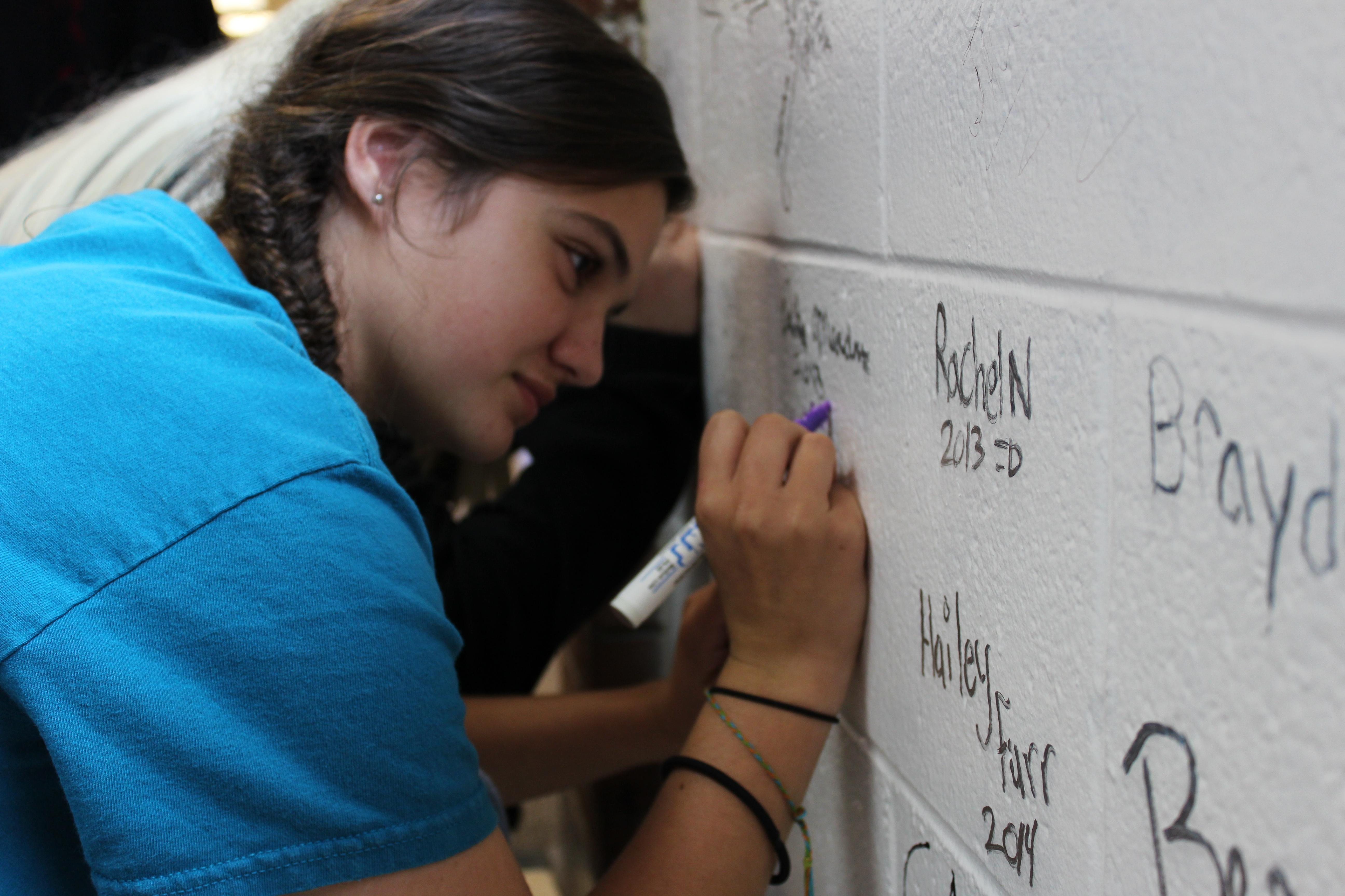 Student signing wall