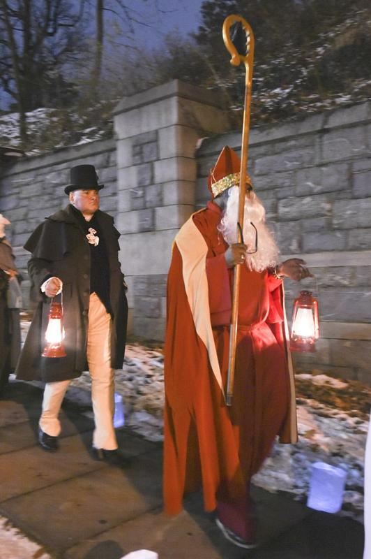 St Nick leading the parade to Moore's gravesite