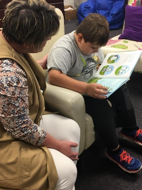 student reading to Mrs. Inman