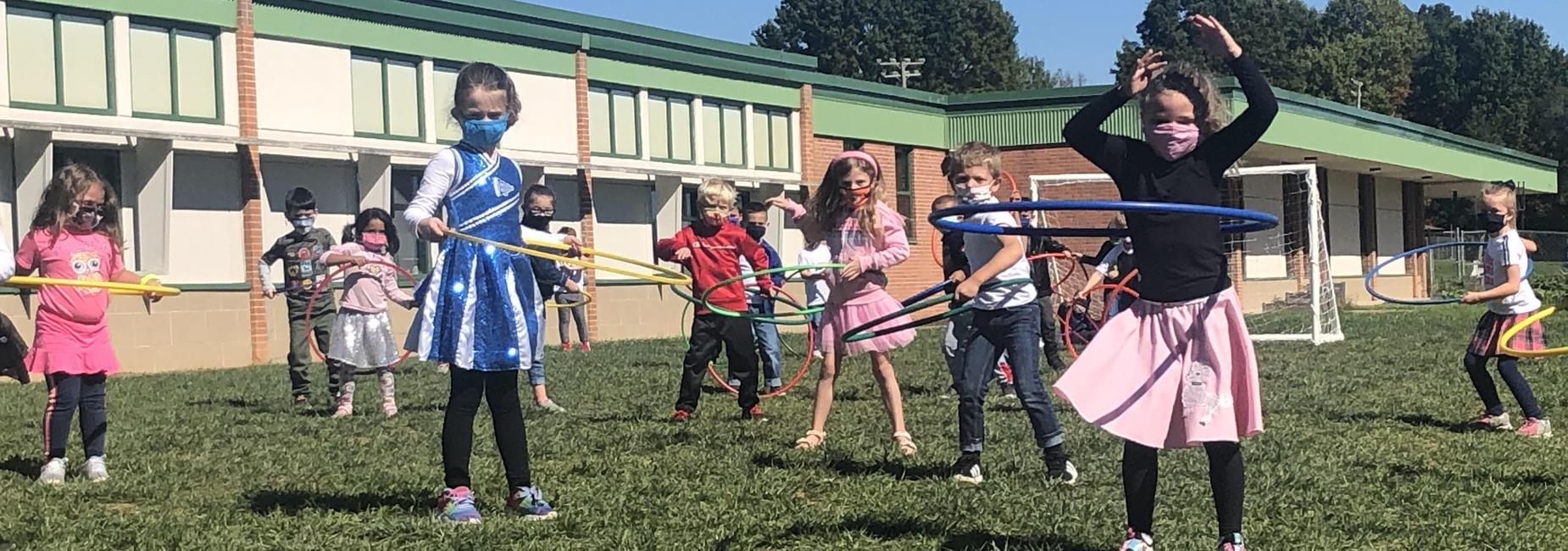 Students hula hoop in PE on the 50th day of school at MES