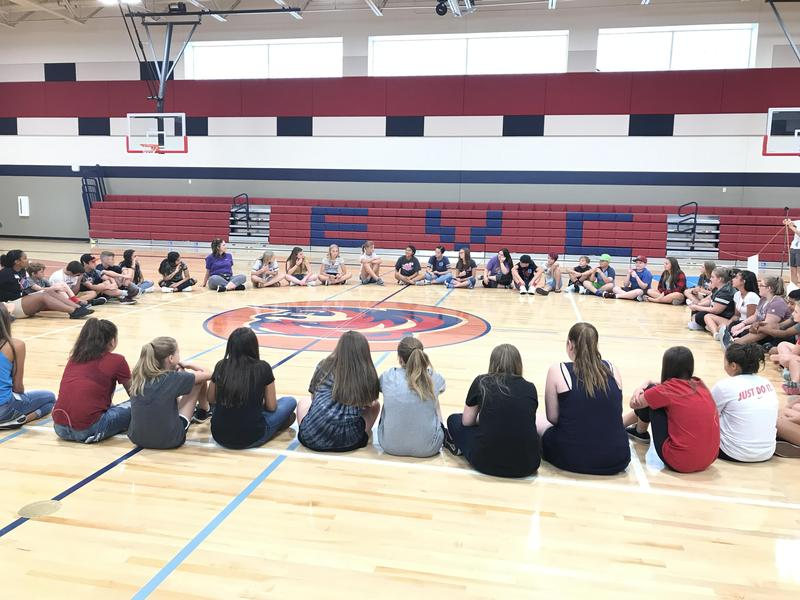 East Valley Central IGNITE students sitting in a circle discussing what they've learned about being good mentors to their peers.