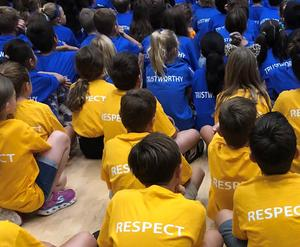 Photo of Franklin students wearing colorful shirts depicting the Six Pillars of Character.