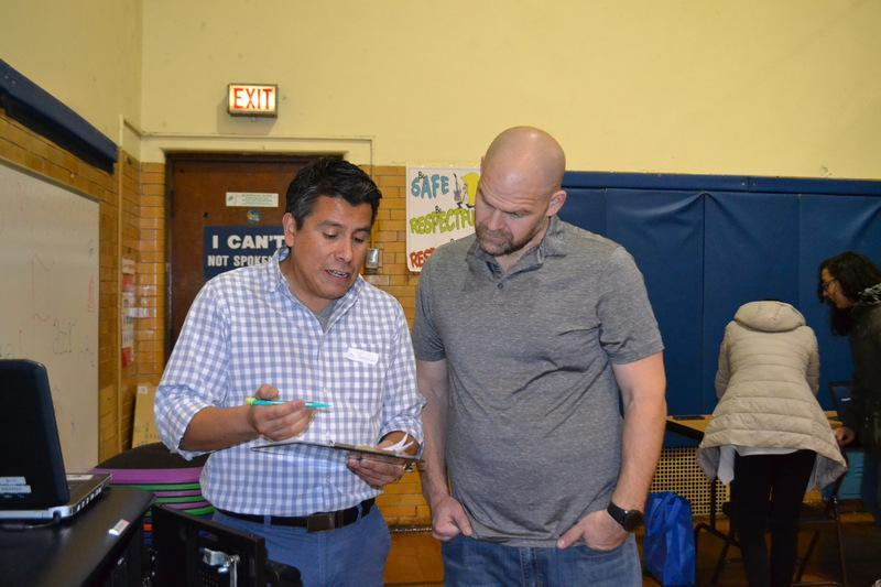 Mr. Hernandez & Mr. L Judging Science Fair