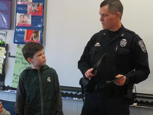 Officer Tom Goggins with his son Colin in Stephanie Woods' second-grade class.