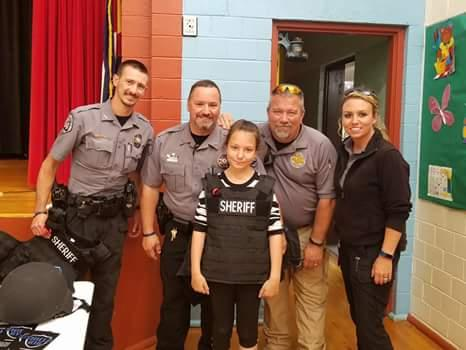 Sheriff deputies with their Shield 616 vests and gear posing with student.