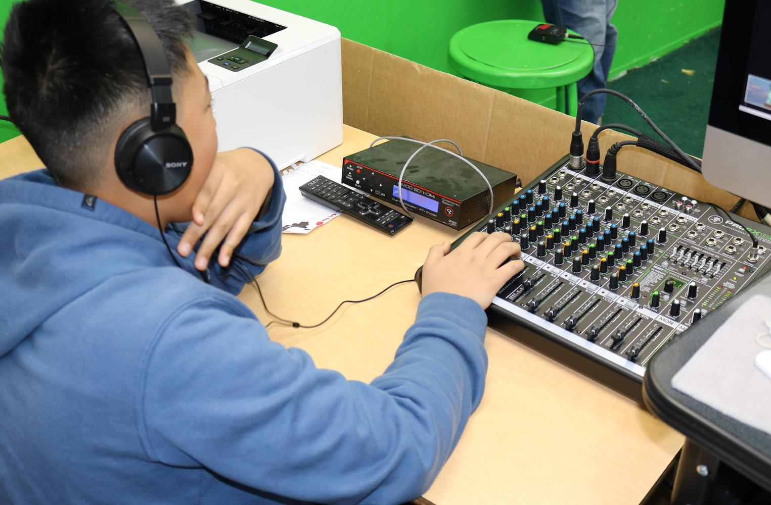 student using audio equipment