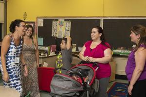 parents and teachers talking at open house