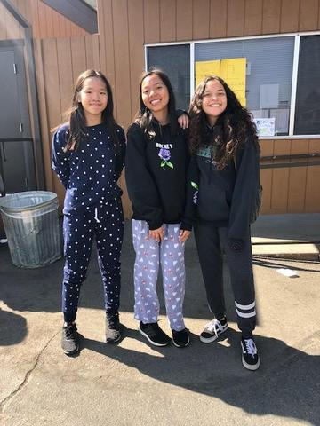 Three CCA students wearing their pajamas.