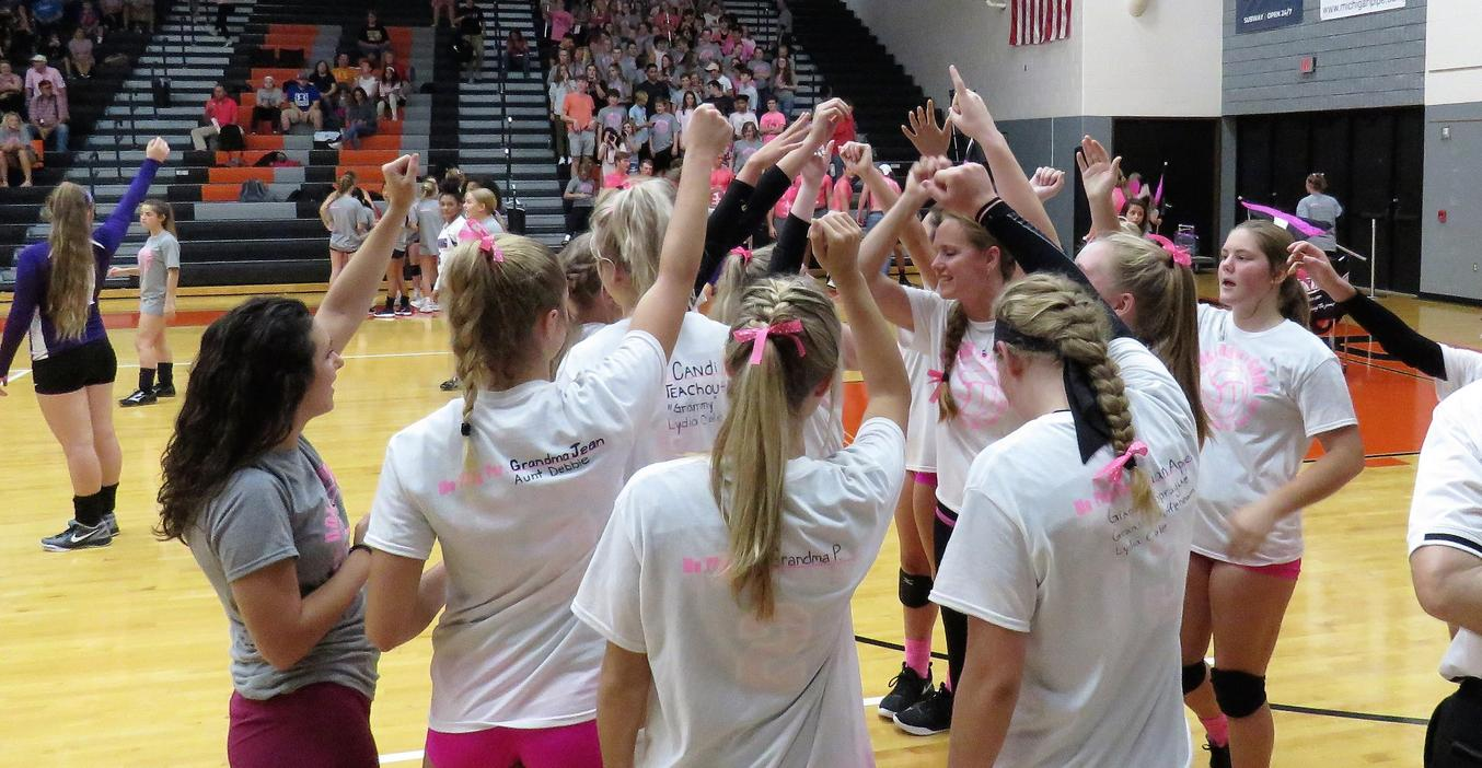 TKHS Volleyball team competes at the annual Pink Out game.