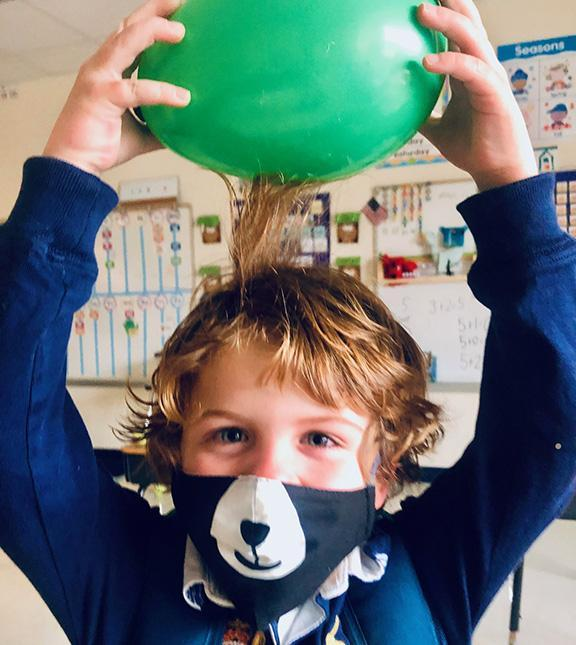 A kindergartener gets a charge out of learning about static electricity.