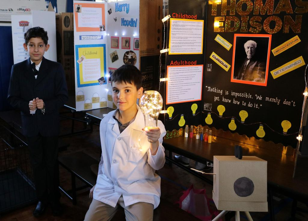"Photo of Wilson 5th graders as Thomas Edison and Harry Houdini at annual ""Wax Museum"" event."