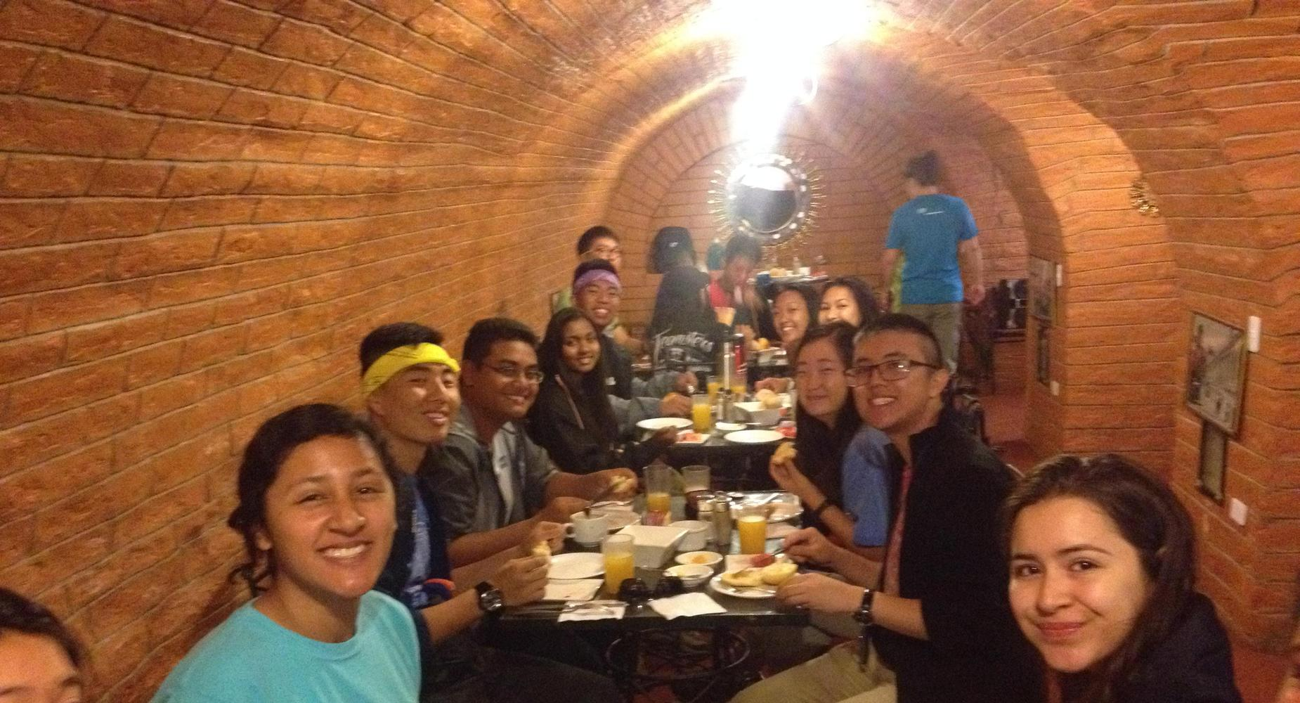 Students in Ecuador eating dinner