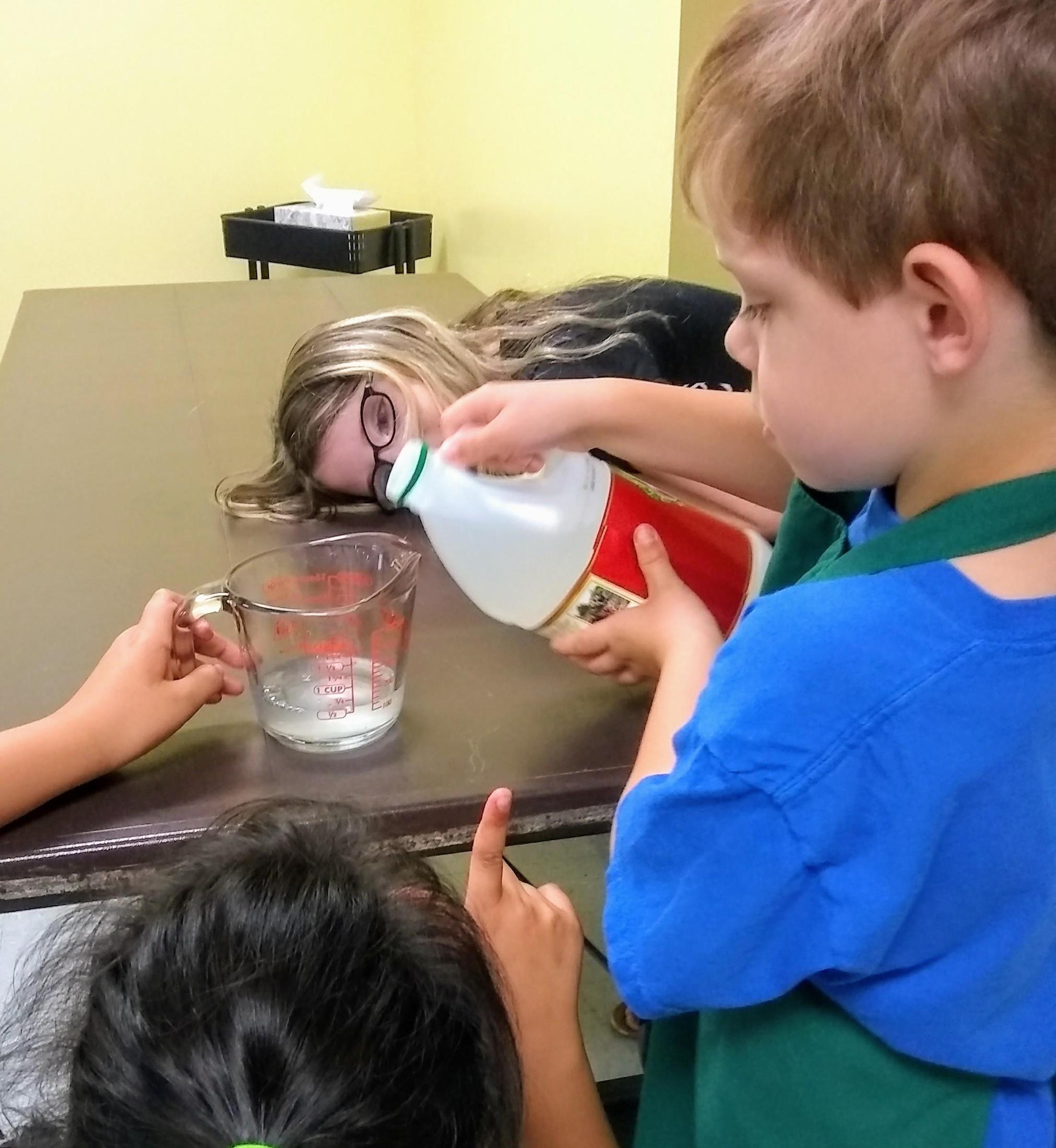 students measuring vinegar into a cup