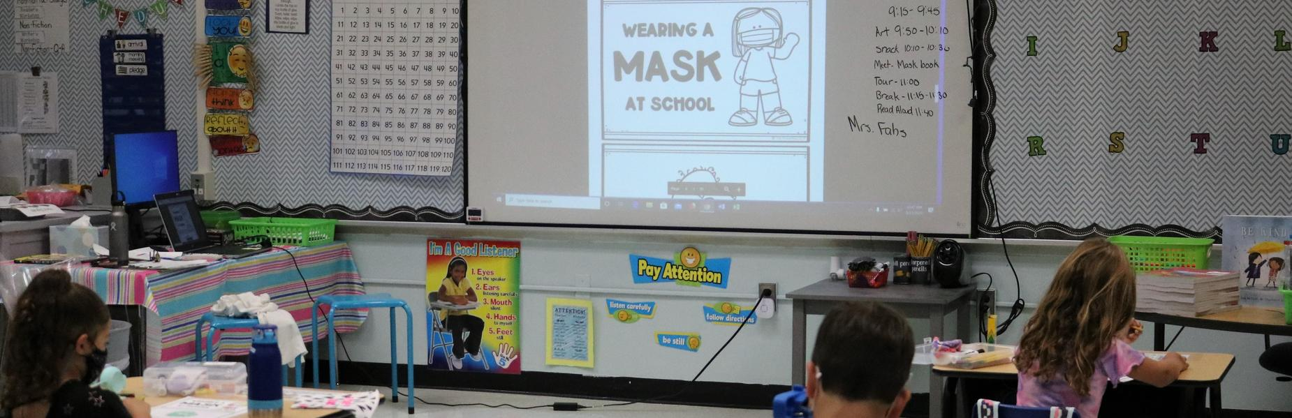Photo of elementary students learning about mask wearing.
