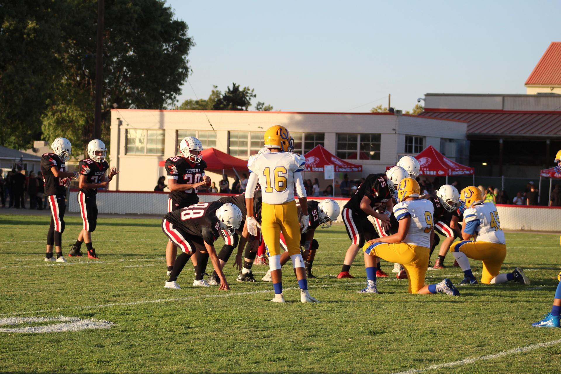 JV football players in action vs Dos Palos