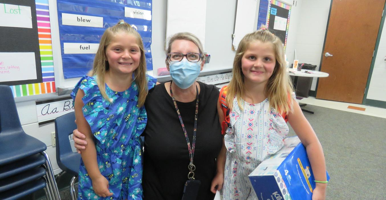 A Lee teacher greets new students to her classroom.